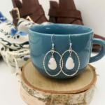 Silver hoop earrings with opal teardrops
